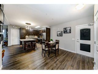 "Photo 3: 204 6470 194 Street in Surrey: Clayton Condo for sale in ""WATERSTONE-ESPLANADE"" (Cloverdale)  : MLS®# R2427138"