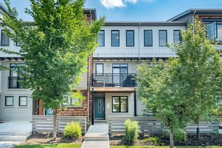 Photo 1: 393 WALDEN Drive SE in Calgary: Walden Row/Townhouse for sale : MLS®# A1126441