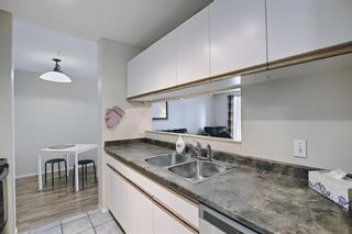 Photo 14: 207 33 Arbour Grove Close NW in Calgary: Arbour Lake Apartment for sale : MLS®# A1135288