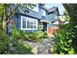Photo 1: 1730 E 7TH Avenue in Vancouver: Grandview VE 1/2 Duplex for sale (Vancouver East)  : MLS®# V1026490