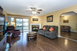 "Photo 1: 219 15153 98 Avenue in Surrey: Guildford Townhouse for sale in ""Glenwood Village"" (North Surrey)  : MLS®# R2233101"