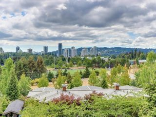 """Photo 1: 317 3082 DAYANEE SPRINGS Boulevard in Coquitlam: Westwood Plateau Condo for sale in """"The Lanterns"""" : MLS®# R2616558"""