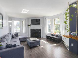 """Photo 2: 311 10743 139 Street in Surrey: Whalley Condo for sale in """"VISTA RIDGE"""" (North Surrey)  : MLS®# R2468543"""