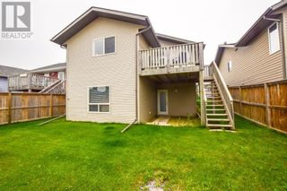 Photo 2: 14 Taylor Drive in Lacombe: House for sale : MLS®# A1131183