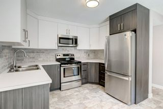 Photo 2: 34 6503 RANCHVIEW Drive NW in Calgary: Ranchlands Row/Townhouse for sale : MLS®# A1018661