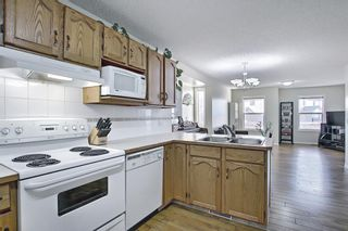 Photo 18: 154 WEST CREEK Bay: Chestermere Semi Detached for sale : MLS®# A1077510