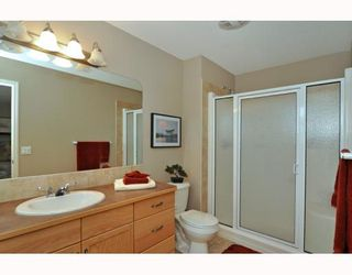 Photo 10: 579 STONEGATE Way NW: Airdrie Residential Attached for sale : MLS®# C3397152