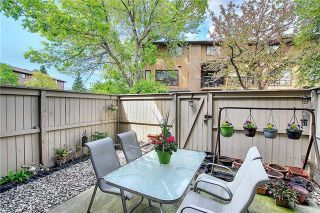 Photo 42: 24 GLAMIS Gardens SW in Calgary: Glamorgan Row/Townhouse for sale : MLS®# A1077235