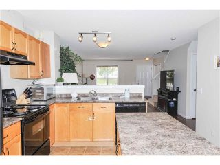Photo 10: 318 TOSCANA Gardens NW in Calgary: Tuscany House for sale : MLS®# C4116517