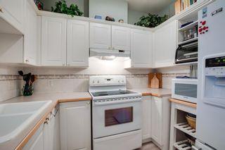 Photo 4: 1213 1213 Lake Fraser Court SE in Calgary: Lake Bonavista Apartment for sale : MLS®# A1087981