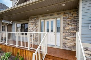 Photo 3: 2 Mackenzie Way: Carstairs Detached for sale : MLS®# A1132226