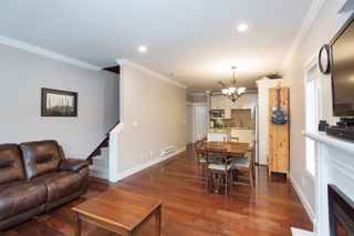 """Photo 7: 101 3333 DEWDNEY TRUNK Road in Port Moody: Port Moody Centre Townhouse for sale in """"CENTREPOINT"""" : MLS®# R2378597"""