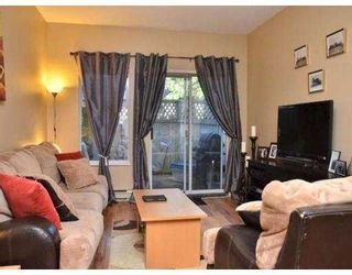Photo 5: 102 450 BROMLEY Street in Coquitlam: Coquitlam East Condo for sale : MLS®# V982968