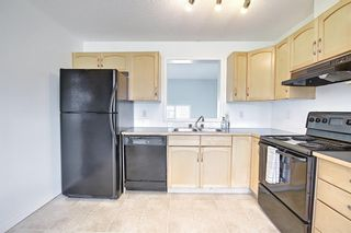 Photo 15: 28 Everhollow Way SW in Calgary: Evergreen Row/Townhouse for sale : MLS®# A1122910