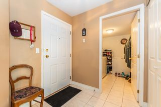 """Photo 2: 106 7685 AMBER Drive in Sardis: Sardis West Vedder Rd Condo for sale in """"The Sapphire"""" : MLS®# R2601700"""