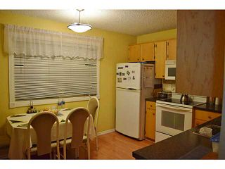 Photo 3: 3118 109 Avenue SW in Calgary: Cedarbrae Residential Attached for sale : MLS®# C3646421