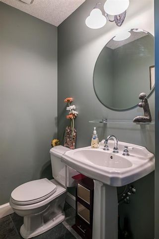 Photo 31: 40 Slopes Grove SW in Calgary: Springbank Hill Detached for sale : MLS®# A1069475