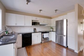 Photo 9: 18 Stradwick Rise SW in Calgary: Strathcona Park Semi Detached for sale : MLS®# A1146925