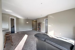 Photo 8: 2413 403 Mackenzie Way SW: Airdrie Apartment for sale : MLS®# A1052642