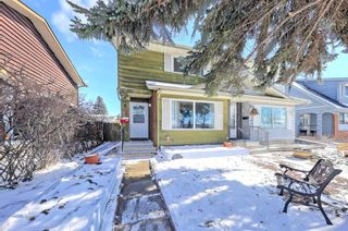 Photo 2: 386 Midridge Drive SE in Calgary: Midnapore Semi Detached for sale : MLS®# A1088291