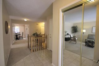 Photo 2: 15 Coach Side Terrace SW in Calgary: Coach Hill Row/Townhouse for sale : MLS®# A1071978
