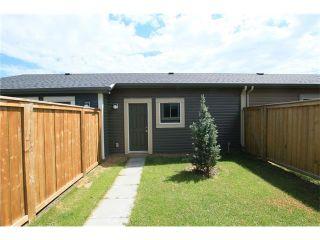 Photo 29: 7 FIRESIDE Parkway: Cochrane House for sale : MLS®# C4068645