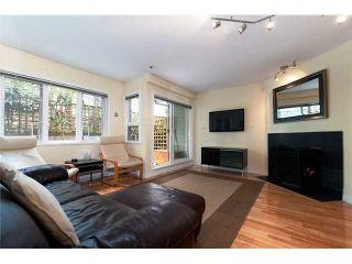"""Photo 2: 2259 ASH Street in Vancouver: Fairview VW Condo for sale in """"THE COURTYARDS"""" (Vancouver West)  : MLS®# V966973"""