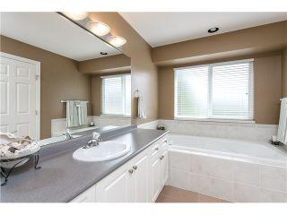 "Photo 11: 12090 237A Street in Maple Ridge: East Central House for sale in ""FALCON RIDGE ESTATES"" : MLS®# V1074091"