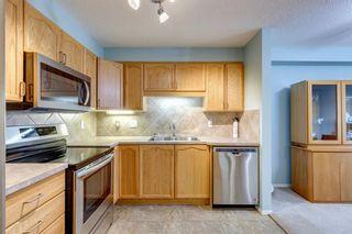 Photo 3: 1205 200 Community Way: Okotoks Apartment for sale : MLS®# A1107550