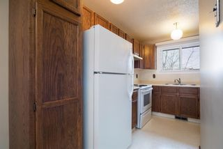 Photo 7: 5 903 67 Avenue SW in Calgary: Kingsland Row/Townhouse for sale : MLS®# A1079413