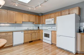 Photo 11: 127 Somerside Grove SW in Calgary: Somerset Detached for sale : MLS®# A1134301