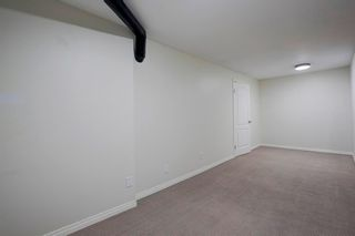 Photo 25: 212 Coachway Lane SW in Calgary: Coach Hill Row/Townhouse for sale : MLS®# A1153091
