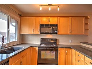 Photo 18: 248 54 GLAMIS Green SW in Calgary: Glamorgan House for sale : MLS®# C4109785