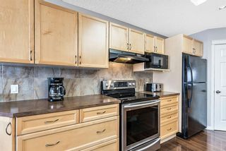 Photo 12: 75 Crystal Shores Crescent: Okotoks Detached for sale : MLS®# A1096925