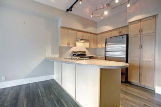 Photo 3: 512 205 Riverfront Avenue SW in Calgary: Chinatown Apartment for sale : MLS®# A1145354