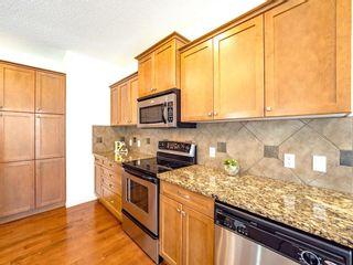 Photo 9: 79 ASPEN HILLS Way SW in Calgary: Aspen Woods Detached for sale : MLS®# A1144436