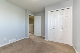 Photo 13: 58 Arbours Circle NW: Langdon Row/Townhouse for sale : MLS®# A1137898