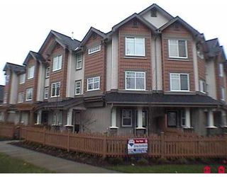 "Photo 1: 8717 159TH Street in Surrey: Fleetwood Tynehead Townhouse for sale in ""Springfield Gardens"" : MLS®# F2623924"