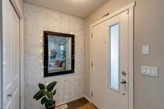 Photo 2: 69 Walden Drive SE in Calgary: Walden Semi Detached for sale : MLS®# A1127735