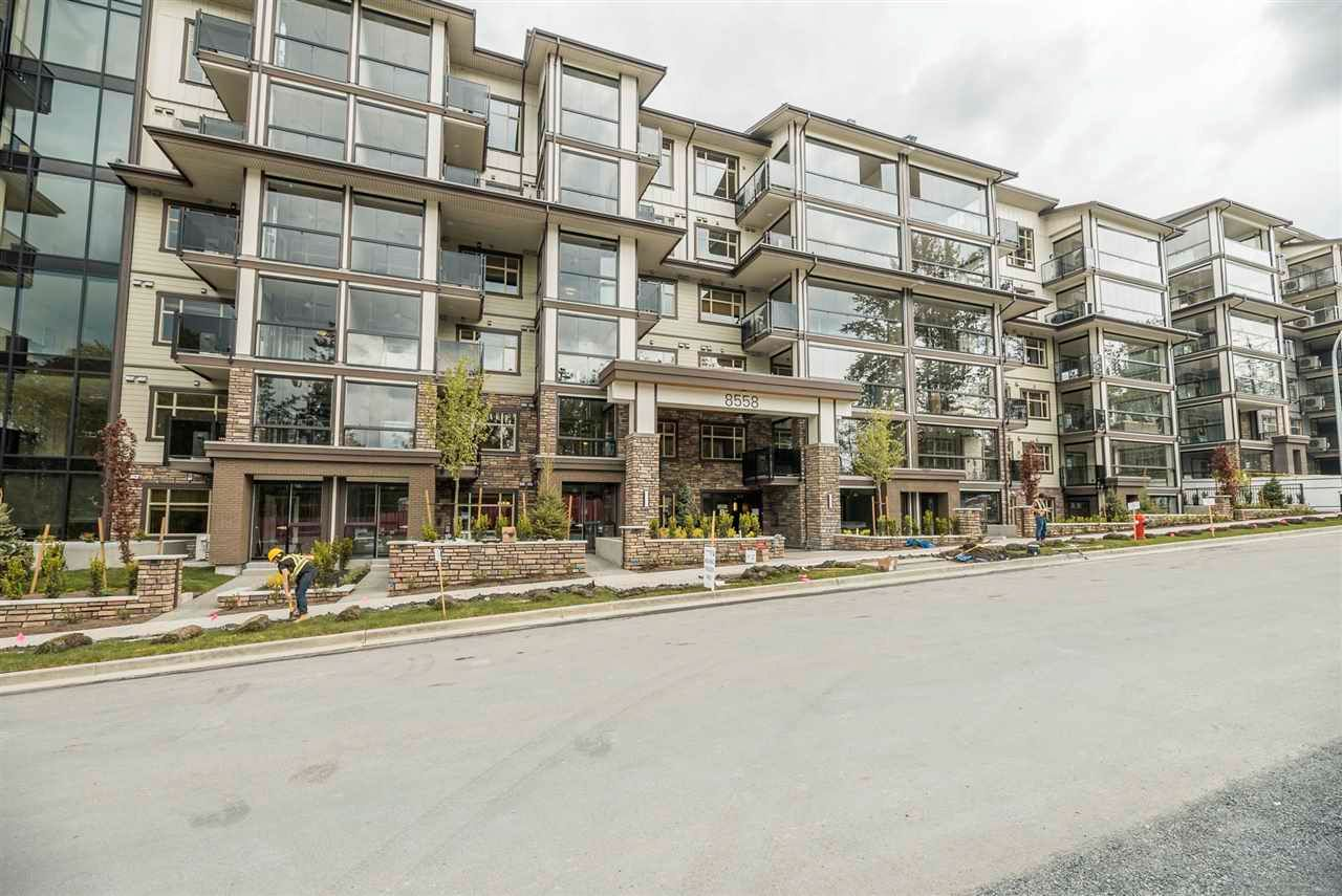 """Main Photo: 406 8561 203A Street in Langley: Willoughby Heights Condo for sale in """"Yorkson Park Central"""" : MLS®# R2590946"""