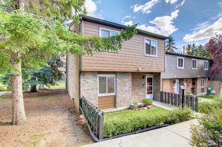 Photo 3: 104 210 86 Avenue SE in Calgary: Acadia Row/Townhouse for sale : MLS®# A1148130