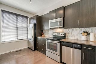 Photo 10: 235 ASCOT Circle SW in Calgary: Aspen Woods Row/Townhouse for sale : MLS®# A1025064