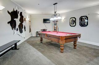Photo 27: 306 77 George Fox Trail: Cochrane Apartment for sale : MLS®# A1139159