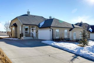 Photo 1: 56 Tuscany Village Court NW in Calgary: Tuscany Semi Detached for sale : MLS®# A1079076