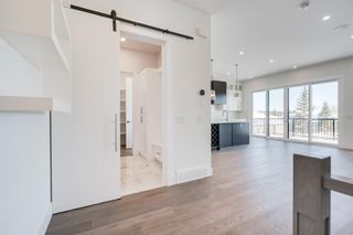Photo 5: 18 Straddock Bay SW in Calgary: Strathcona Park Detached for sale : MLS®# A1086418