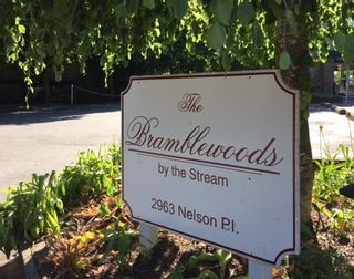 "Photo 1: 303 2963 NELSON Place in Abbotsford: Central Abbotsford Condo for sale in ""THE BRAMBLEWOODS BY THE STREAM"" : MLS®# R2175532"