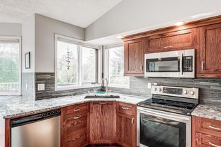 Photo 5: 104 Woodmark Crescent SW in Calgary: Woodbine Detached for sale : MLS®# A1128002