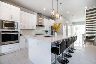 Photo 9: 231 13 Avenue NW in Calgary: Crescent Heights Detached for sale : MLS®# A1148484