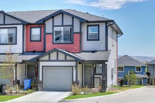 Photo 1: 705 Jumping Pound Common: Cochrane Row/Townhouse for sale : MLS®# A1124366