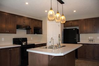 Photo 5: 14 HILLCREST Street SW: Airdrie Detached for sale : MLS®# A1031272